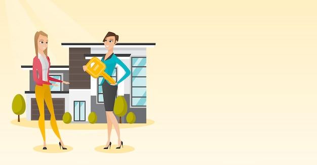 Agente imobiliário dando a chave para um novo dono de casa. Vetor Premium
