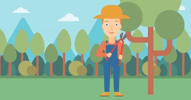 Agricultor, com, podador, em, jardim Vetor Premium