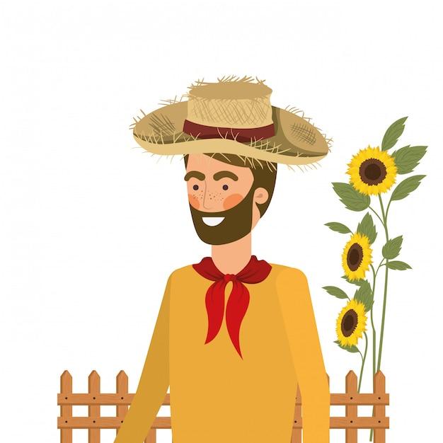 Agricultor de homem com chapéu de palha e girassóis Vetor Premium