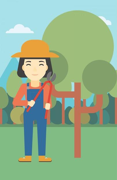 Agricultor feminino usando podador Vetor Premium