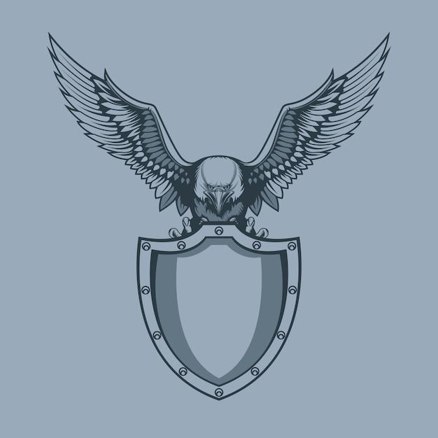 Águia com escudo em garras Vetor Premium