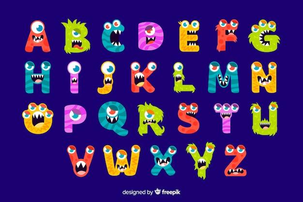Alfabeto colorido monstro de halloween Vetor grátis