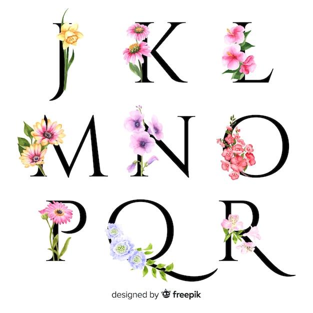 Alfabeto com flores realistas Vetor grátis