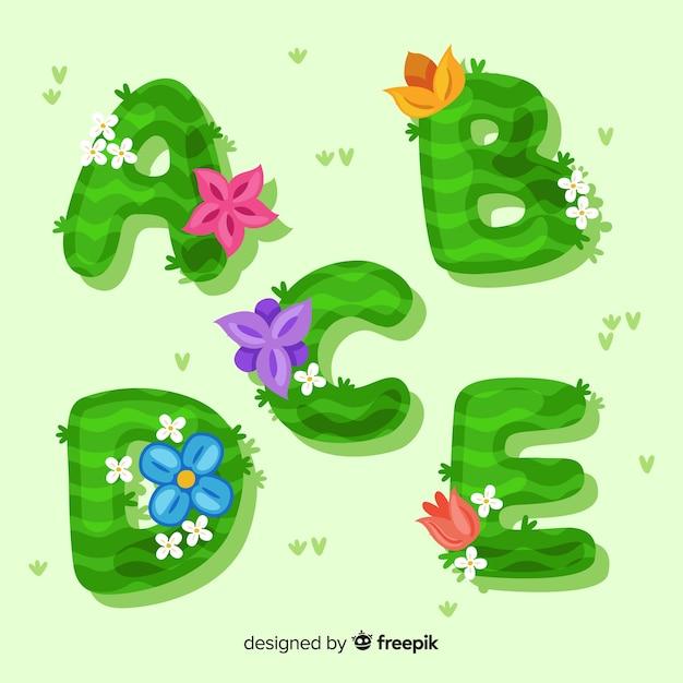 Alfabeto floral colorido mão desenhada Vetor grátis
