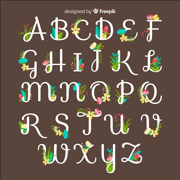 Alfabeto floral colorido Vetor grátis