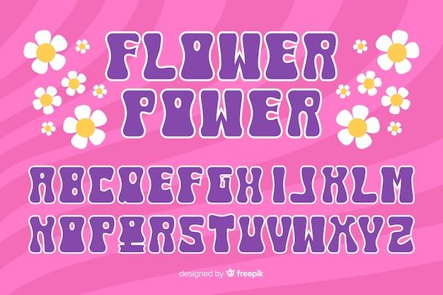 Alfabeto floral no estilo dos anos 60 em fundo rosa Vetor grátis