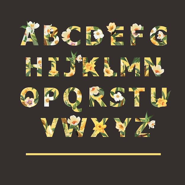 Alfabeto tropical serif font verão amarelo tipográfico com plantas folhagens Vetor grátis