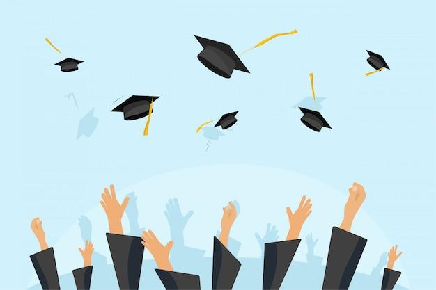 Alunos de graduação ou as mãos do aluno em vestido jogando bonés de formatura no ar Vetor Premium