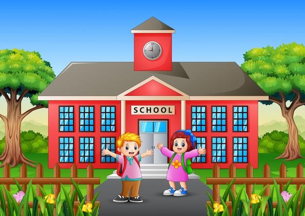 Alunos felizes vão à escola pela manhã Vetor Premium
