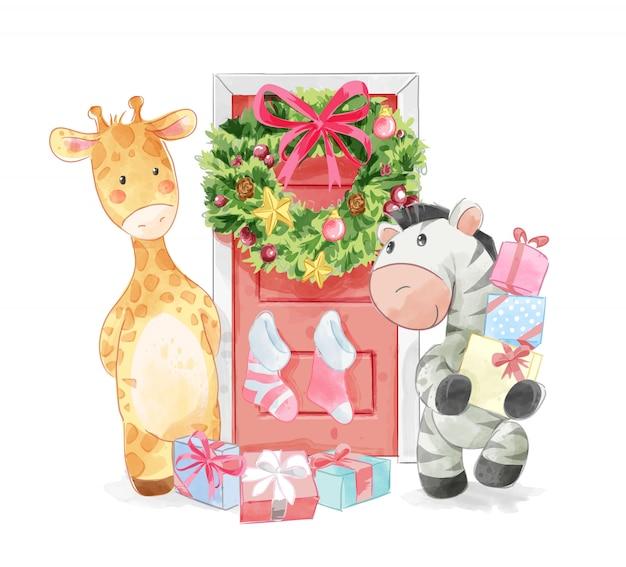 Amigos animais com porta de natal decorada Vetor Premium