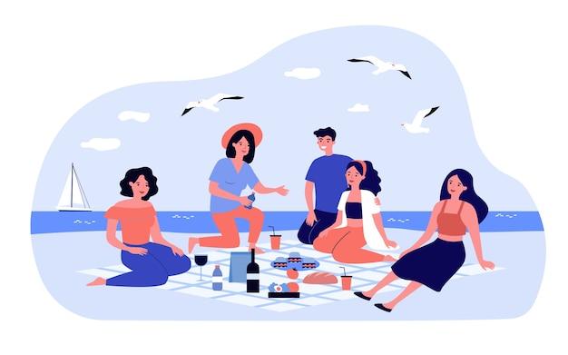 Amigos fazendo piquenique no mar. grupo de pessoas felizes sentadas na praia com alimentos e bebidas na manta. ilustração para lazer, verão, conceitos à beira-mar Vetor Premium