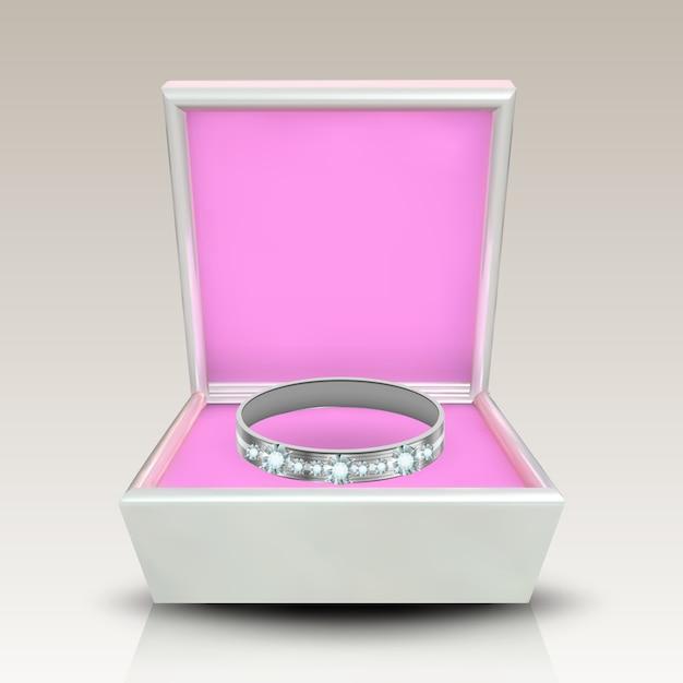 Anel de prata incrustado em caixa quadrada branca Vetor Premium