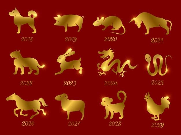Animais do zodíaco horóscopo chinês ouro. símbolos do ano isolado em pano de fundo vermelho Vetor Premium