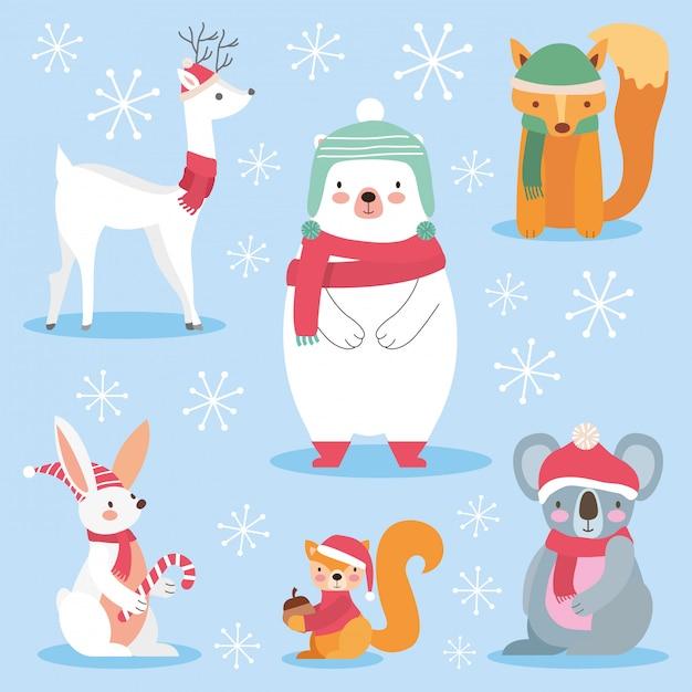 Animais fofos com roupas de natal. Vetor Premium