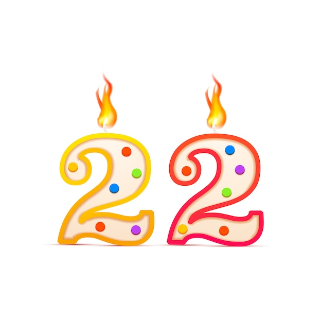 Aniversário de vinte e dois anos, número 22 em forma de vela de aniversário com fogo isolado no branco Vetor Premium