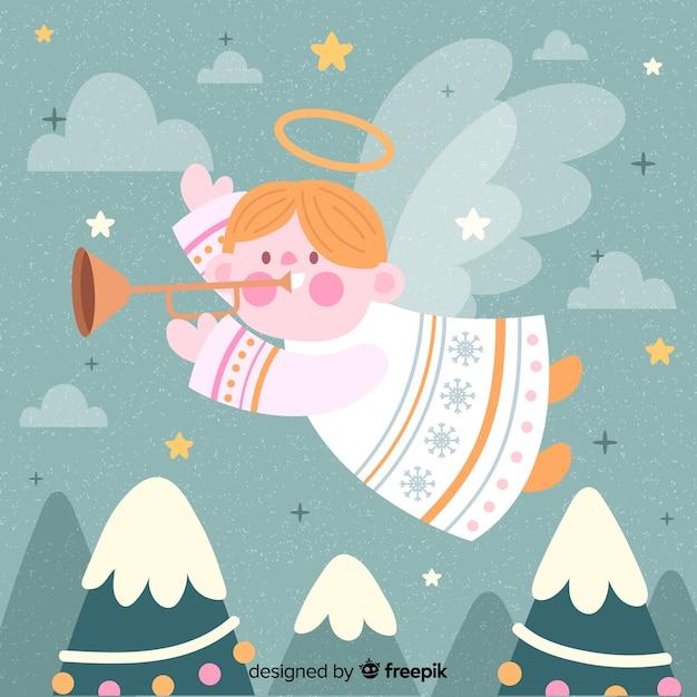 Anjo de natal bonito desenhado de mão Vetor grátis