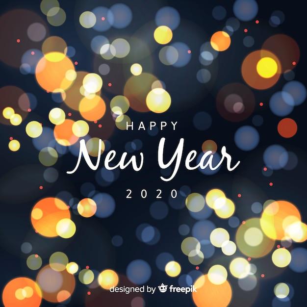 Ano novo conceito com efeito bokeh Vetor grátis