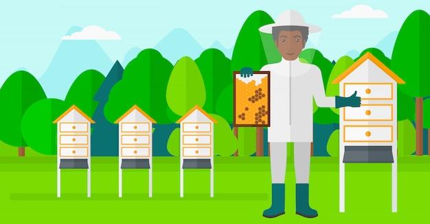 Apicultor no apiário. Vetor Premium