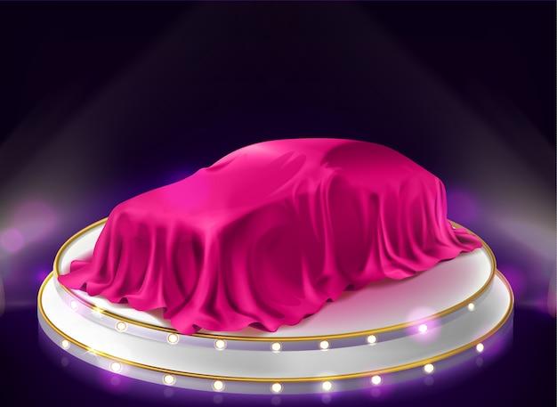 Apresentação do carro, auto coberto com véu no palco Vetor grátis