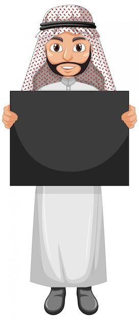 Árabe adulto vestindo traje árabe e segurando um cartaz ou cartaz em branco Vetor grátis