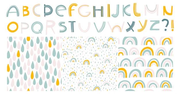 Arco-íris e gotas. alfabeto e padrões sem emenda. criança escandinava mão ilustrações desenhadas em tons pastel. conjunto isolado para impressão em camisetas, têxteis, cartões Vetor Premium