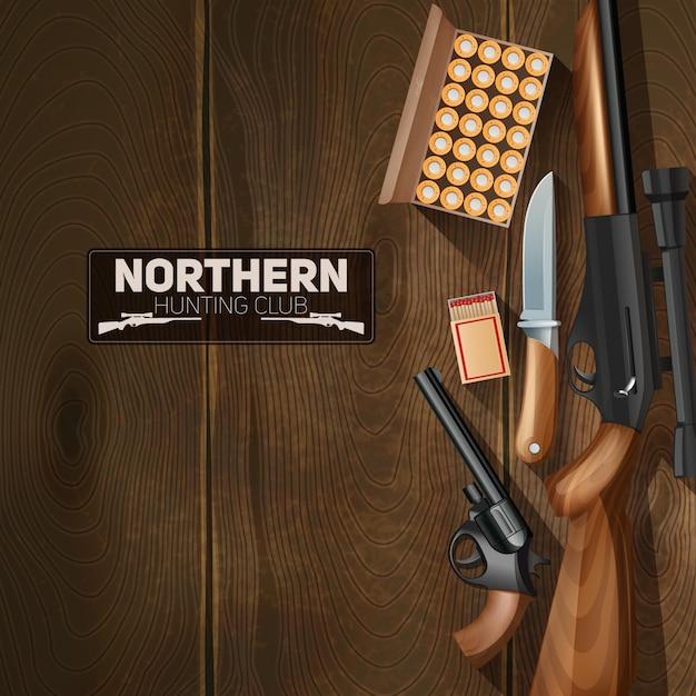 Arma de caça e balas em fundo de textura de madeira Vetor grátis