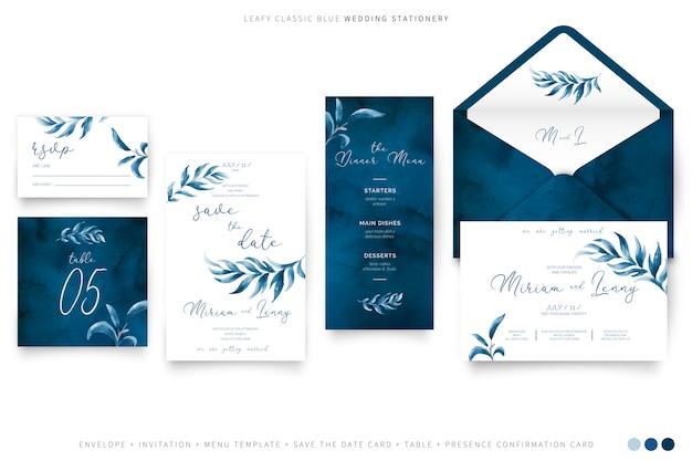 Artigos de papelaria frondosos do casamento na cor azul clássica Vetor grátis