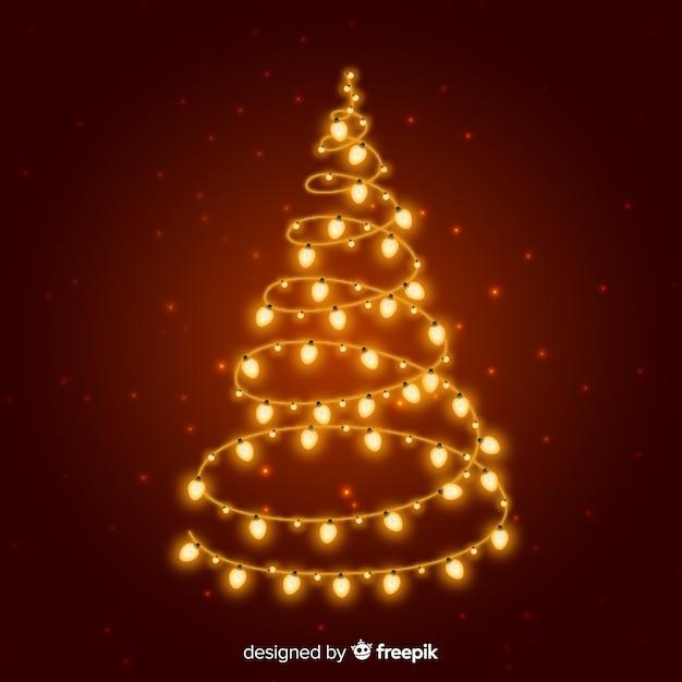 Árvore de natal de luzes douradas Vetor grátis