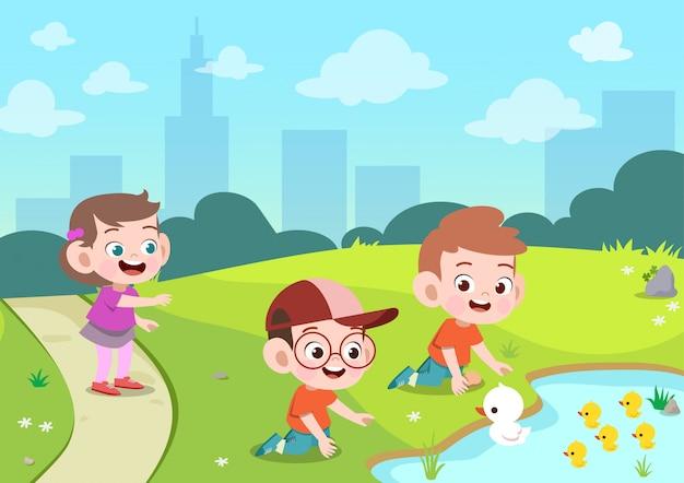 As crianças brincam patos na ilustração vetorial jardim Vetor Premium