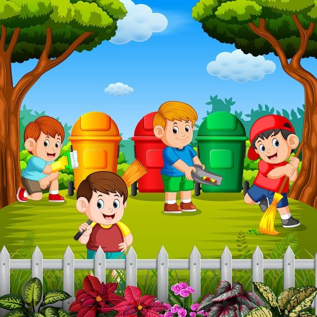 As crianças limpam o jardim e jogam o lixo em uma lixeira nas três cores Vetor Premium