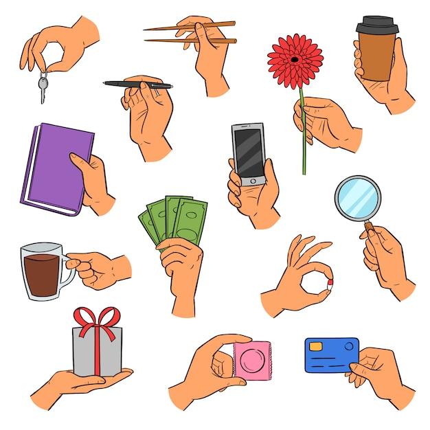As mãos armam segurando smartphone ou xícara de café e dedos mostrando cartões de crédito ou presentes conjunto de ilustração de mão com livro ou flor em fundo branco Vetor Premium