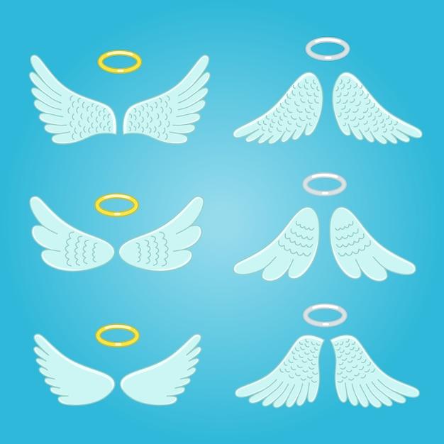 Asas e nimbus. asas de anjos de penas Vetor Premium