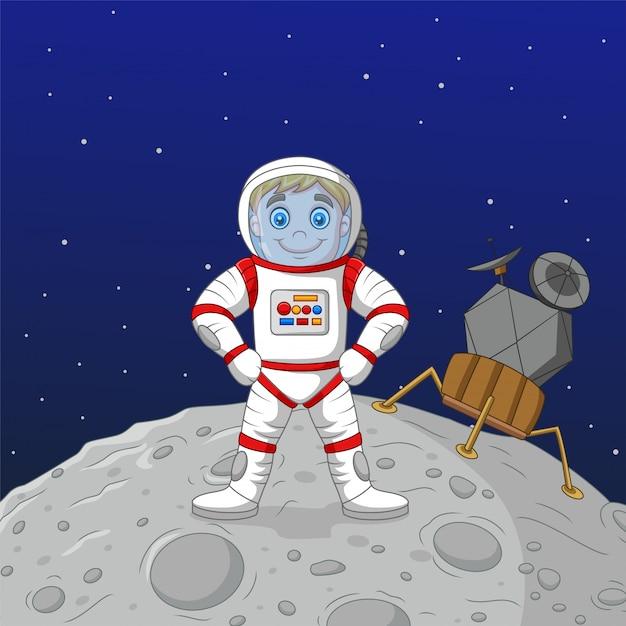 Astronauta de menino dos desenhos animados em pé na lua Vetor Premium