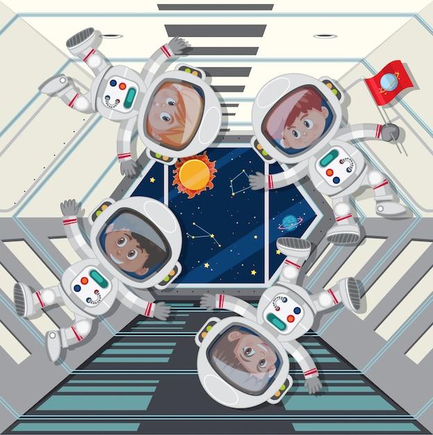 Astronautas flutuando na nave espacial Vetor Premium