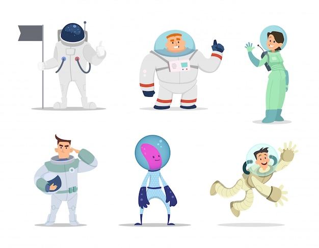 Astronautas masculinos e femininos. personagens de desenhos animados em poses de ação Vetor Premium
