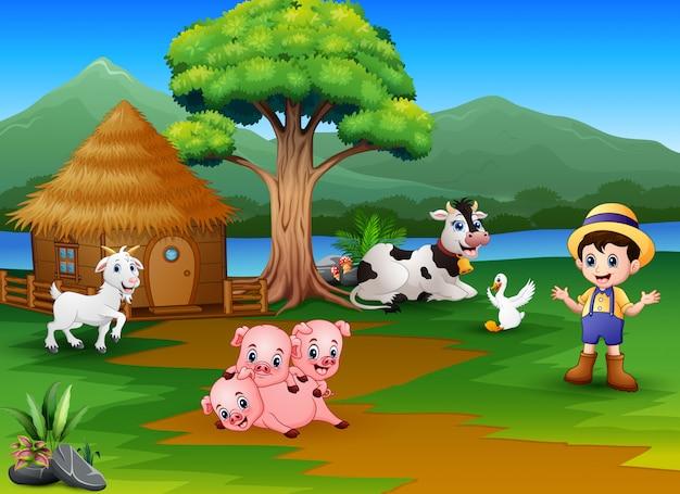 Atividade do fazendeiro na bela natureza com fazenda animal Vetor Premium