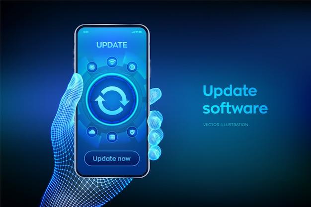 Atualizar o conceito de versão de software na tela do smartphone. closeup smartphone na mão de wireframe. Vetor Premium