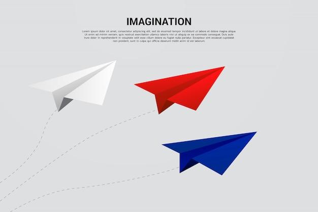 Avião de papel origami vermelho azul e branco voando Vetor Premium