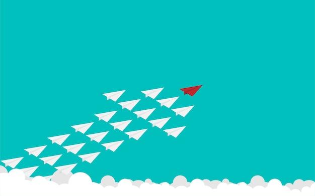 Avião de papel vermelho e muitos brancos no céu Vetor Premium