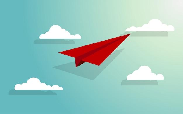 Avião de papel voando através do grupo de nuvens Vetor Premium