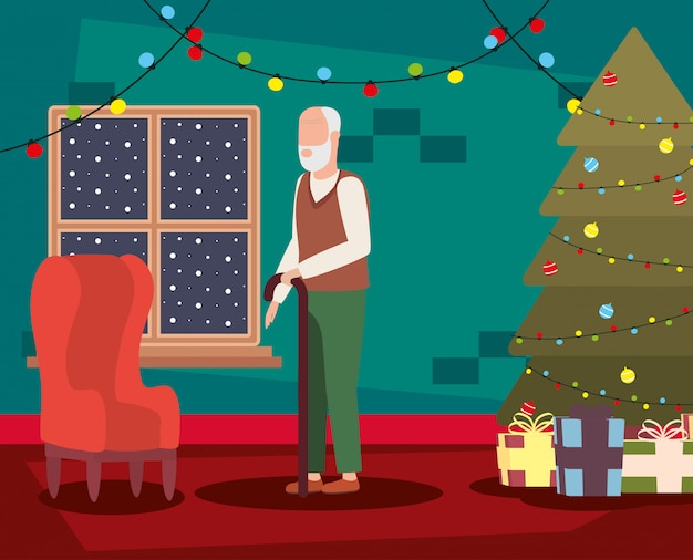 Avô na sala de estar com decoração de natal Vetor grátis