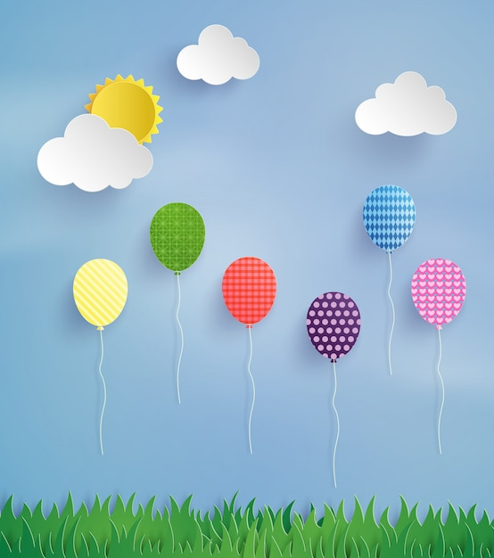 Balão colorido voando alto no ar Vetor Premium