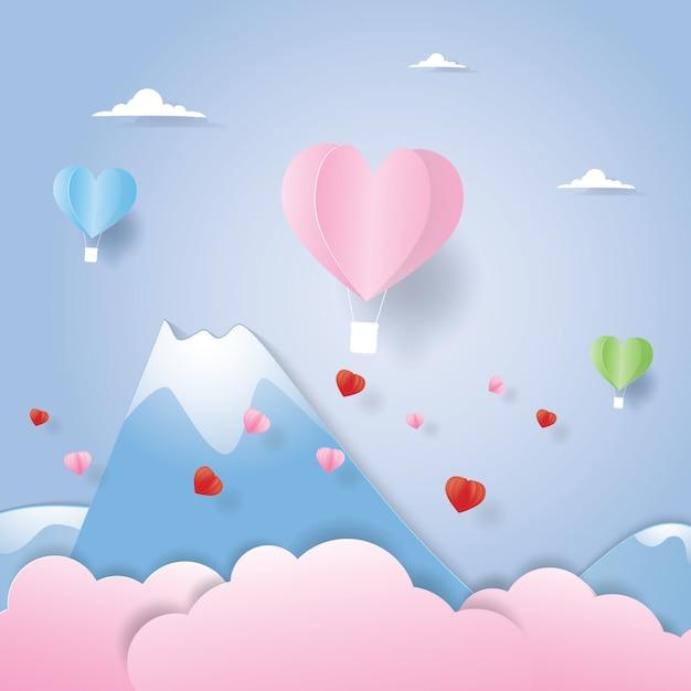 Balão de ar quente voando acima da montanha em papel cortado Vetor Premium