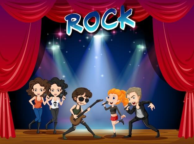 Banda de rock tocando no palco Vetor grátis