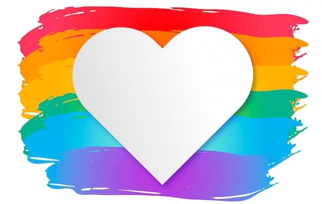 Bandeira colorida do orgulho com coração vazio. dia mundial do orgulho Vetor grátis