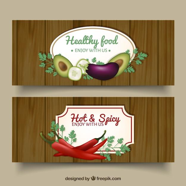 Bandeiras de madeira do vintage com especiarias e alimentos saudáveis Vetor grátis