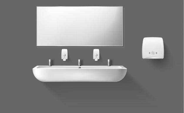 Banheiro público com pia de cerâmica e espelho Vetor grátis