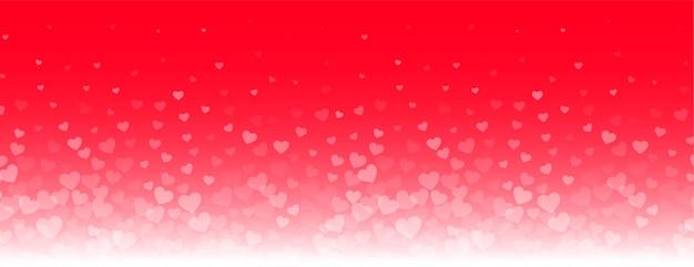 Banner adorável de corações brilhantes em fundo vermelho Vetor grátis
