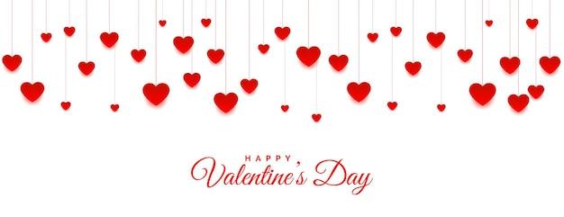 Banner de corações pendurados para dia dos namorados Vetor grátis
