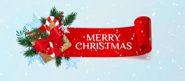 Banner de feliz natal com caixa de presente, bastão de abeto e doces. natal. Vetor Premium